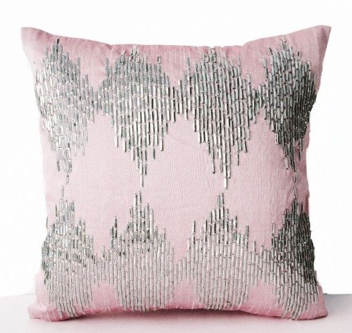Sequin embellished light pink art silk pillowcase with metallic silver ikat pattern embroidery. These unique sequins give a vibrant sparkle with silvery shine. Use it to add a captivating element of g