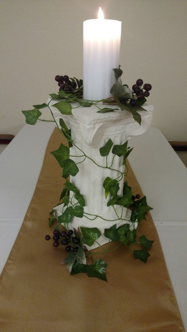 Centerpieces for our Ancient Rome theme party Greenery