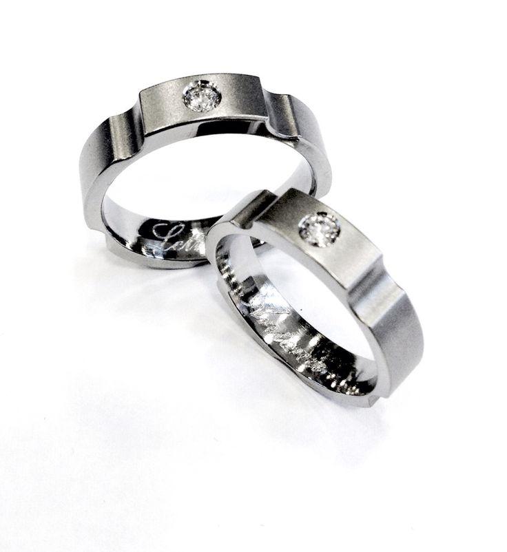 Titanium rings with diamonds, custom project. Finishes: Internal polish, external sandblasted Anelli in titanio e diamanti, progetto personalizzato. Finiture: Lucidato internamente e sabbiato esternamente.