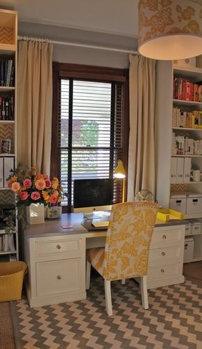 work area by the window. Flank desk with tall bookshelves. Elongate area by hanging ceiling to floor curtains.