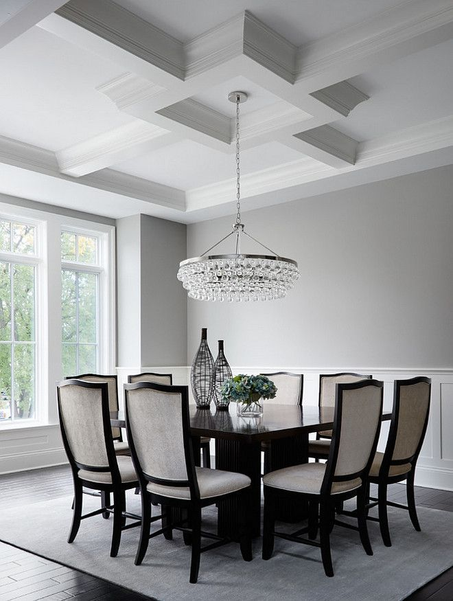 Dining room features a Robert Abbey Bling Chandelier. | Summit Signature Homes, Inc.