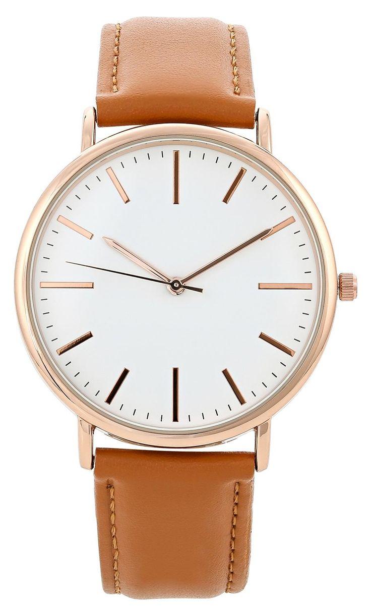 Klassiek bruin horloge voor dames Dit klassieke horloge is ontwikkeld in een prachtige luxe stijl. Dit horloge heeft een bruin lederen band. De horlogekast heeft een rosé gouden toon. De wijzers en nummeraanduiding hebben dezelfde kleur als de kast. De wijzerplaat is in het wit.  De hele lengte van dit horloge is 24 centimeter. De breedte van de horlogeband is 2 centimeter. De diameter van de horlogekast is 3.8 centimeter.