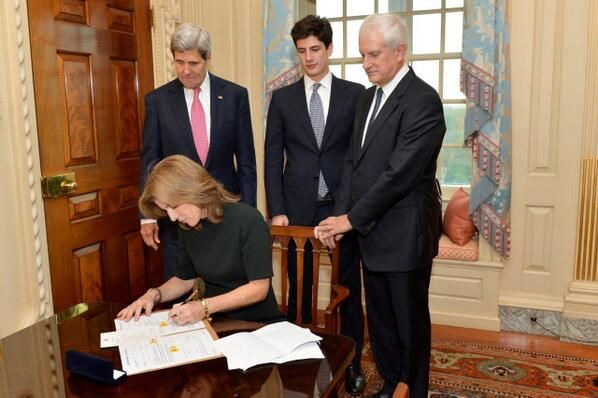 "U.S. Secretary of State John Kerry swears in Caroline Kennedy as U.S. Ambassador to Japan at the U.S. Department of State in Washington, D.C., on November 12, 2013. Ambassador Kennedy is accompanied by her husband, Dr. Edwin Schlossberg, and son, John ""Jack"" Schlossberg."
