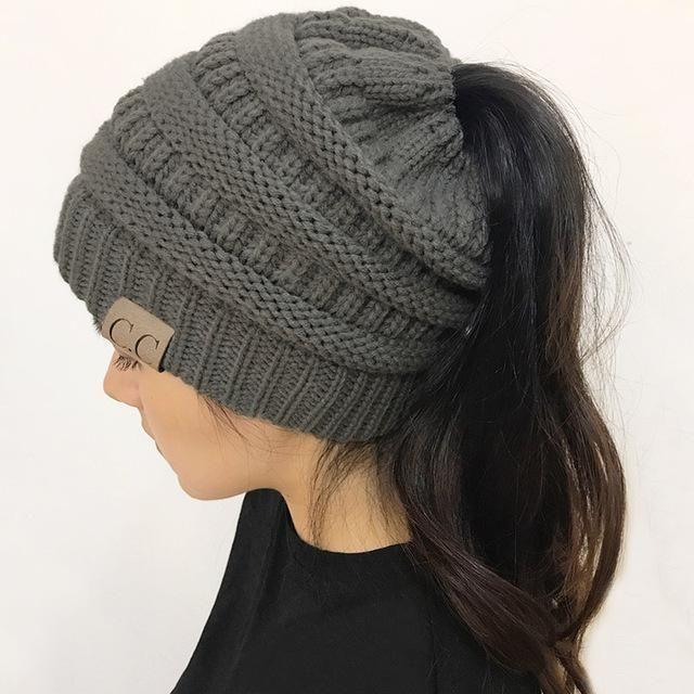 2018 CC Warm Winter Hat For Women Ponytail Beanie Stretch Cable Knit Messy Bun Hats Soft Ski Cap Wholesale #HatsForWomen2018