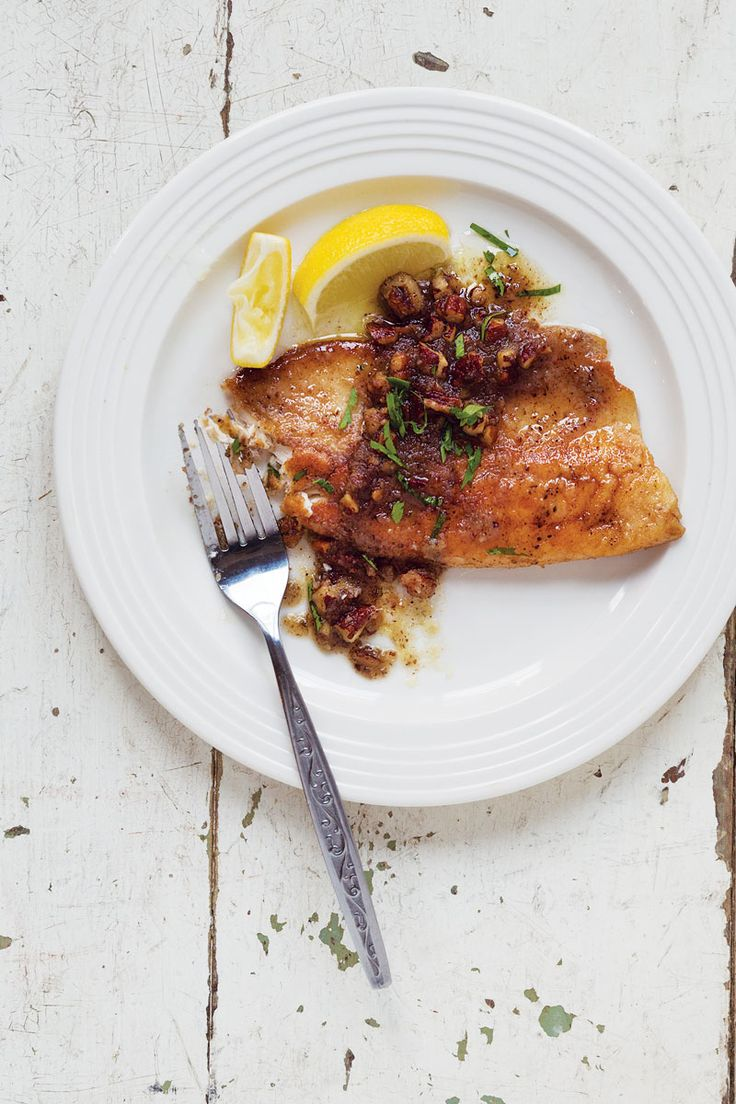 Pan-Seared Trout with Pecan Brown Butter Sauce: A buttery pecan-accented sauce tops moist trout filets in this twist on trout amandine.
