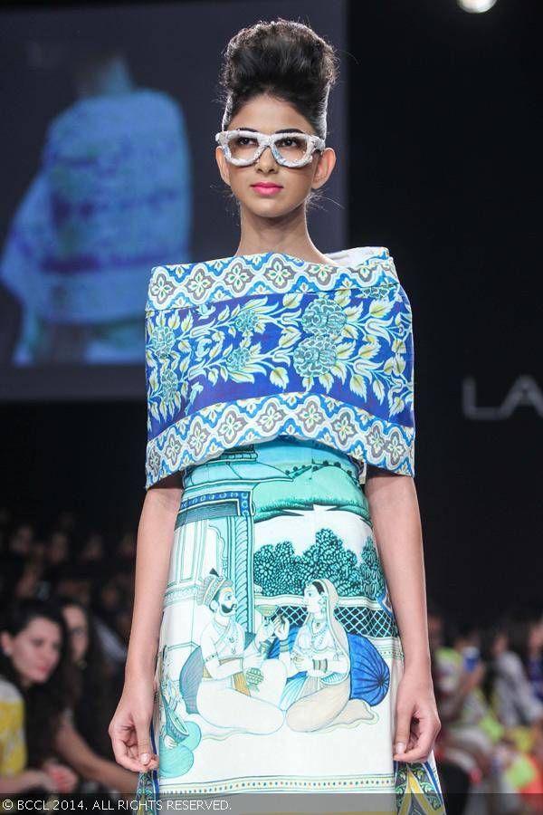 A model showcases a design by Aartivijay Gupta on Day 3 of the Lakme Fashion Week (LFW) Summer Resort 2014, held at Grand Hyatt, Mumbai, on March 13, 2014.