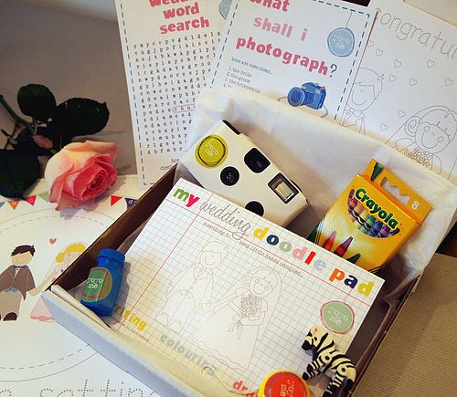 "wedding activity box for kids - disposable camera, ""picture search"", wedding word search, handmade wedding coloring book/crayons, finger puppets, stuffed animal, treats... CUte packaging ideas too."