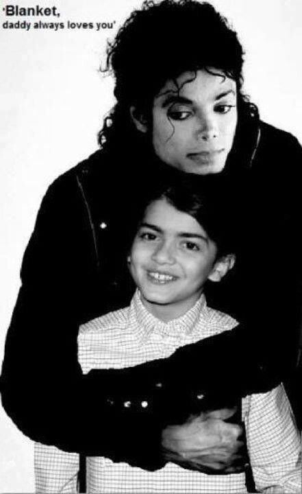 A loving and kind daddy! Michael Jackson and blanket
