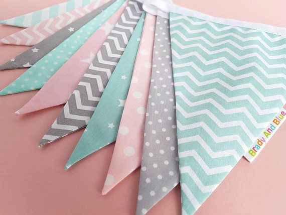 This pastel fabric bunting in shades of pink, mint and grey would look amazing in any babys nursery or girls bedroom. Bunting is a perfect gift for a birth, Christening, baby shower or birthday. It would also look great as a back drop at a cake smash photo shoot! This handmade nursery