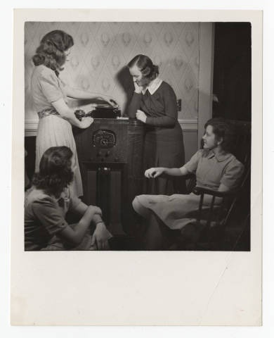 Students operating a radio phonograph :: Archives & Special Collections Digital Images :: 1945