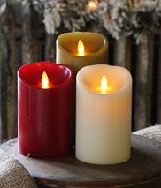 """Flickering Flame-less Candles- Ok we have established I am a dork, but I love these candles I just set a timer and they go on and off and I can put them in places I would never put an open flame. If you position them right you really can't tell that they are not """"real""""."""