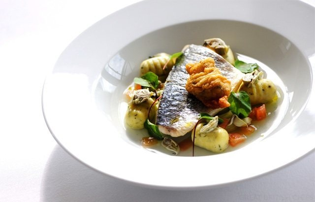Steamed fillet of sea bream with a nage of Cornish oyster, tomatoes and cucumber and herb gnocchi -  Robert Thompson