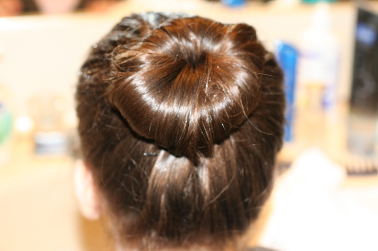 http://habby.hubpages.com/hub/How-to-Put-Hair-in-a-Perfect-Ballet-Bun
