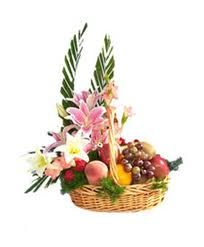 Flora Fruit  (Fresh Fruits Hamper)  Surprise someone special by sending this unique arrangement of Oriental Lily flowers with Fruits(3 kgs)in a cane basket.