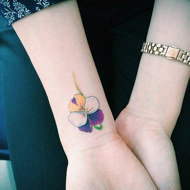 Violet tattoo on the right wrist. Tattoo artist: Doy