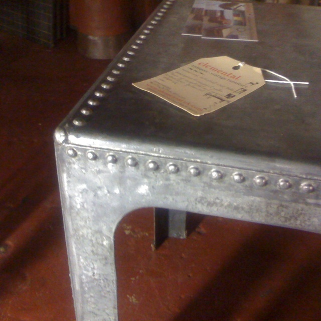 Up-cycled water tank table.