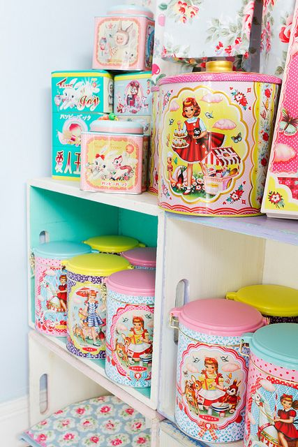 Pretty tins. I have quite a few of these in the pantry. Some of them play music. ~Louie Louie Bebe~