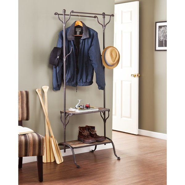 LAUNDRY ROOM - entryway with a stylish, multifunctional hall tree! The storage and versatility will work wonders for your home. The aged metal frame and distressed fir finish with scraped blue and yellow paint colorations offer a charming, rustic style. Four hooks, two hanging bars, and two shelves offer the ideal storage for entryway essentials like hats or shoes. This convenient hall tree is perfect for the entryway or mudroom. Rustic beauty and a fashionable flair make this piece a…