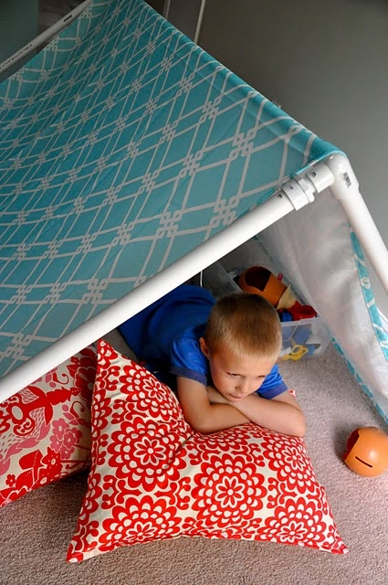 indoor tent made from a tablecloth and PVC pipe