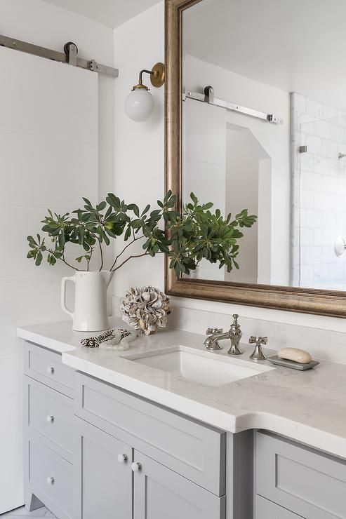 A Gold Leaf Beveled Vanity Mirror Hangs Above A Gray Extra Wide