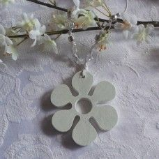 Wedding Charms are given to the bride after she is married – usually when the ceremony is over. These symbols of luck, love, growth or transformation are hung on the bride's wrist as a special token of love and friendship for the new bride. The flower symbolizes, youth, transformation, love, fertility and beauty. Made from craft-wood with specks of luminous glitter, crystal and cord. $16.00au