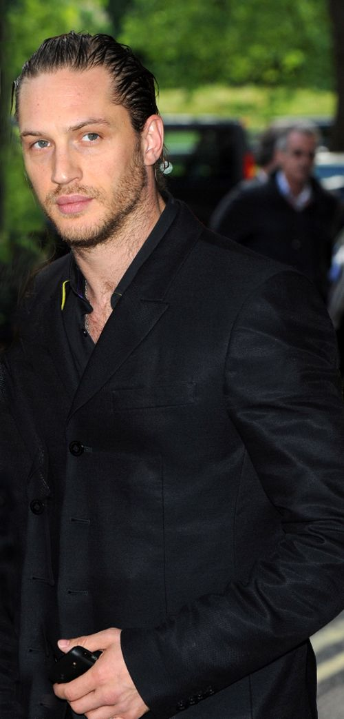 Tom Hardy... excellent silk taffeta looking jacket sad about the sleeve... Tom's too thick latissimus and tricep is making the fabric pull -- cheapo tailor could've gone a bit more on the bias to facilitate more fabric give... but then again, hardy's got a beefy build and all the chicks like that ;)... still, taffeta is a bitch to work with.