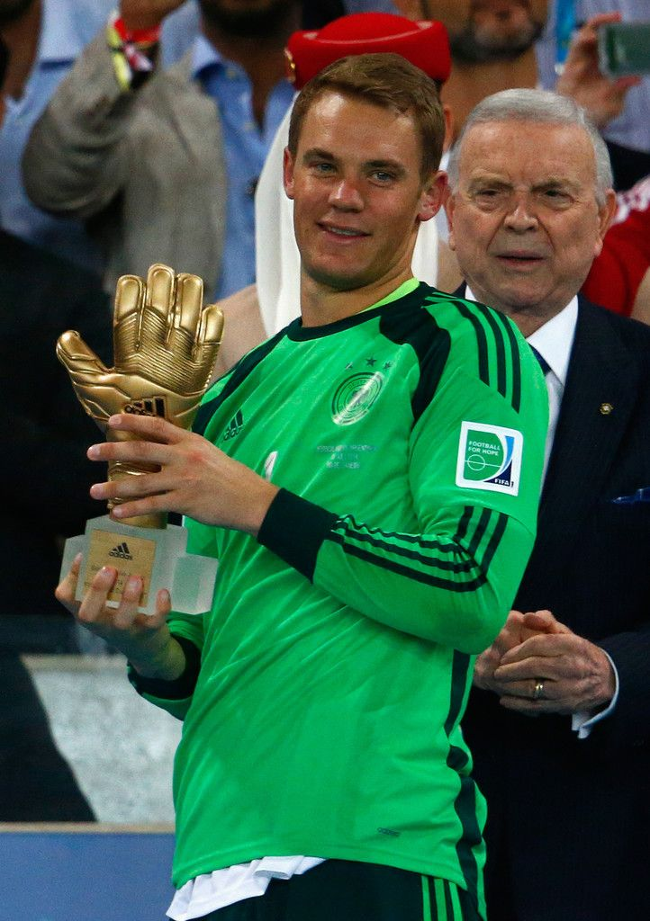 Manuel Neuer of Germany is presented with the Golden Glove trophy during the 2014 FIFA World Cup Brazil Final match between Germany and Argentina at Maracana on July 13, 2014 in Rio de Janeiro, Brazil