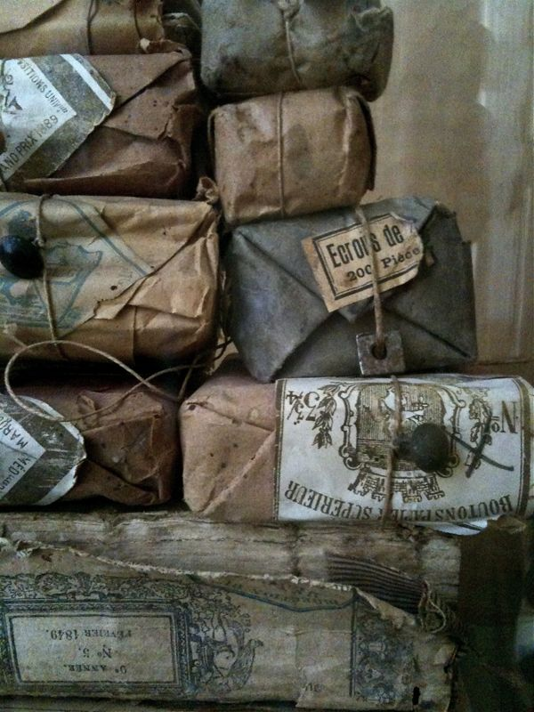 Antique French packages wrapped up with string from Pascale's shop: Vox Populi