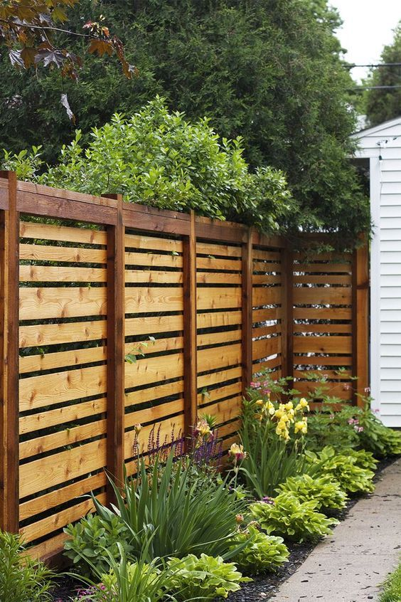 Beautiful wood fence design with various plank sizes