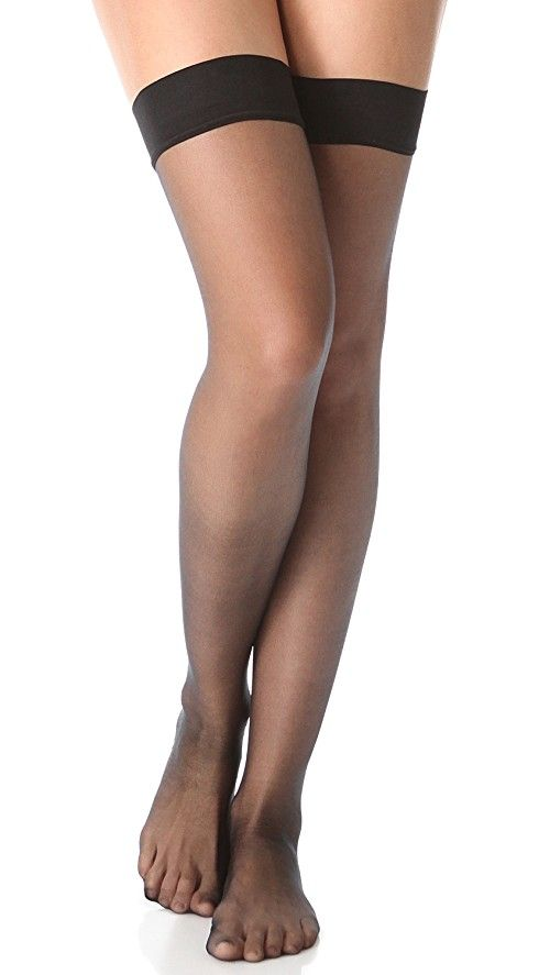 Falke High Heel Stay Up Tights | These sheer thigh-high tights feature a Cuban heel and contrast back seam. 66% polyamide/34% polyurethane. Hand wash. Made in Germany.