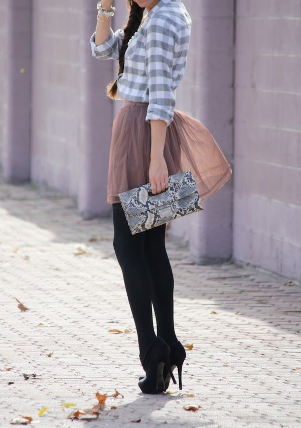 Love. Grey and white gingham blouse tucked into  a mauve skirt with black tights and heels. The snakeskin clutch adds character too!