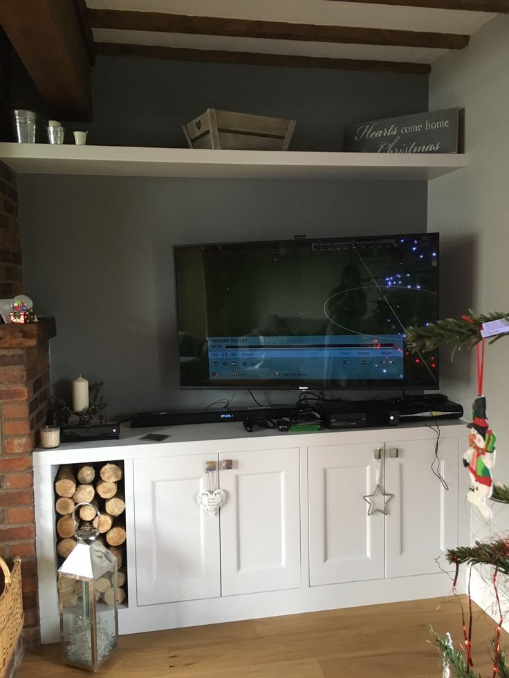 Living room furniture.Fitted Alcoves. Alcove Cabinets. Handmade Alcove Cabinet for T.V and log storage, next to the fire place. Cabinet Maker- Manchester