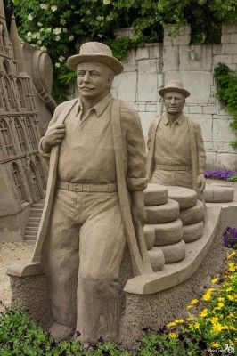 Heavy load...sand sculpture The detail of these men are unbelieveable!