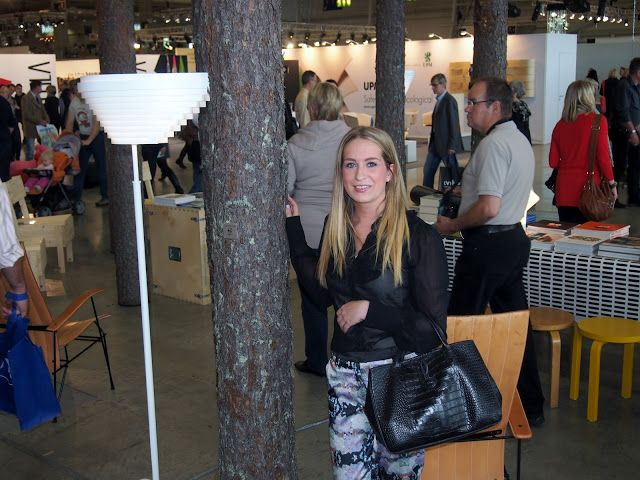 black shirt floral pants trousers habitare fair interior design longchamp bag pants pattern print