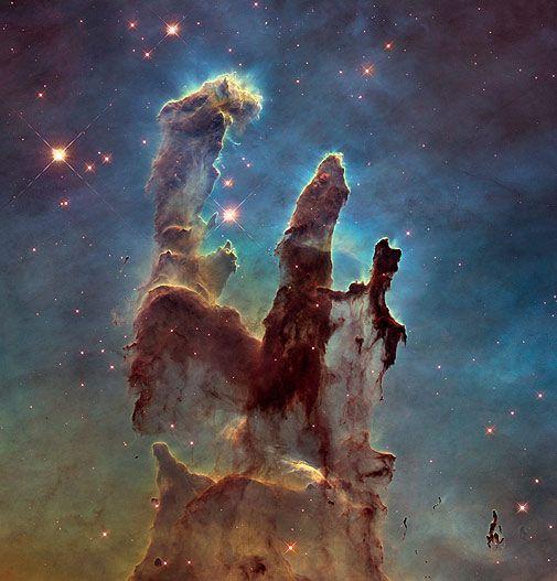 """Geburtsstätte der Sterne: die """"Säulen der Schöpfung"""" im Adlernebel (Foto von: NASA, ESA/Hubble and the Hubble Heritage Team)"""