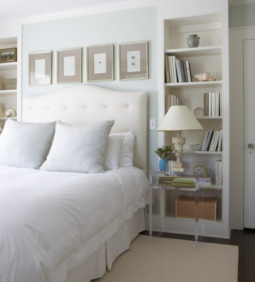 Guest bedroom in whites and blues. Design by Sage Design. Photo by Michael Partenio. Styled by StacyStyle for New England Home.