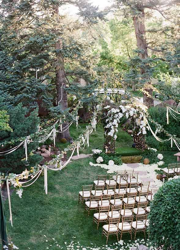 """Because who doesn't remember the jaw dropping ceremony of Edward and Bella? Let the forest be your locale and walk down a lantern-lined aisle to say, """"I do"""" underneath an ethereal floral arbor – talk about breathtaking!"""