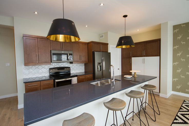 Stan Bailie Kitchen Island seating with Pendant lights