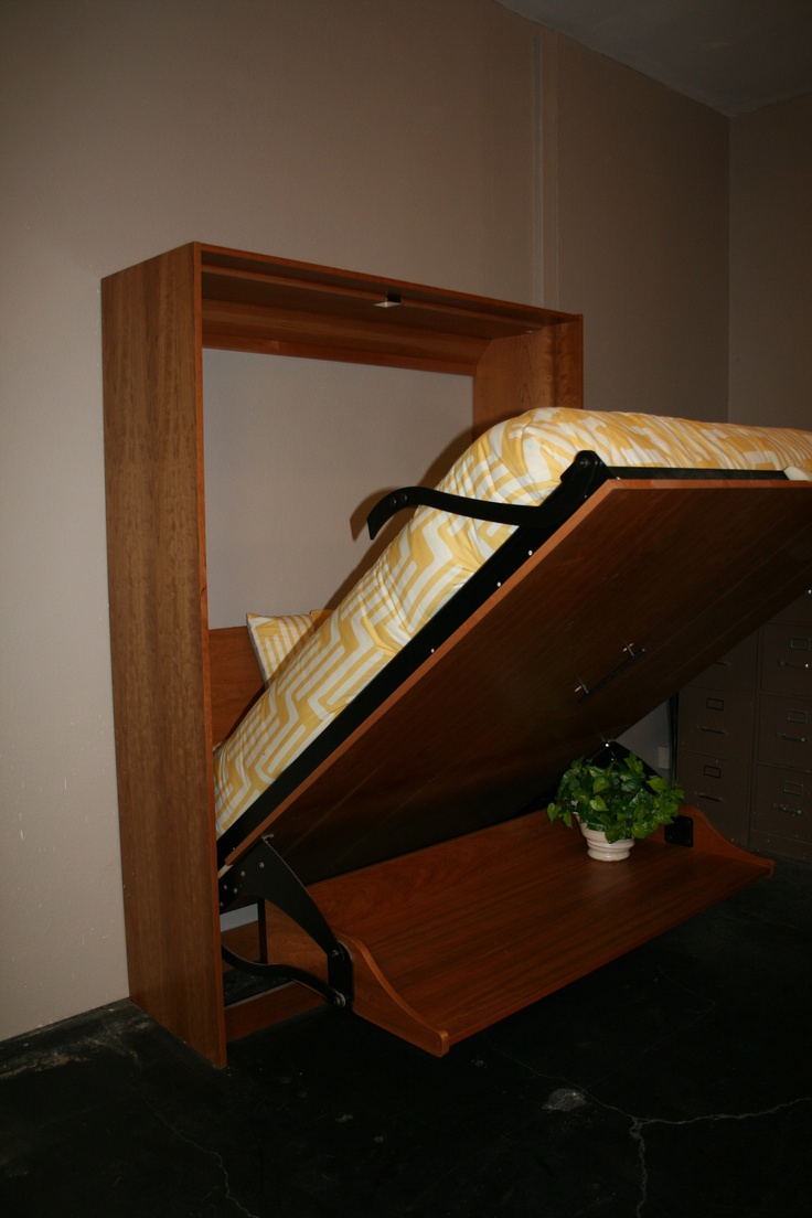 Release the locking mechanism and the bed lowers easily