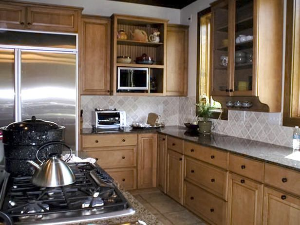 Beige colored kitchen cabinets