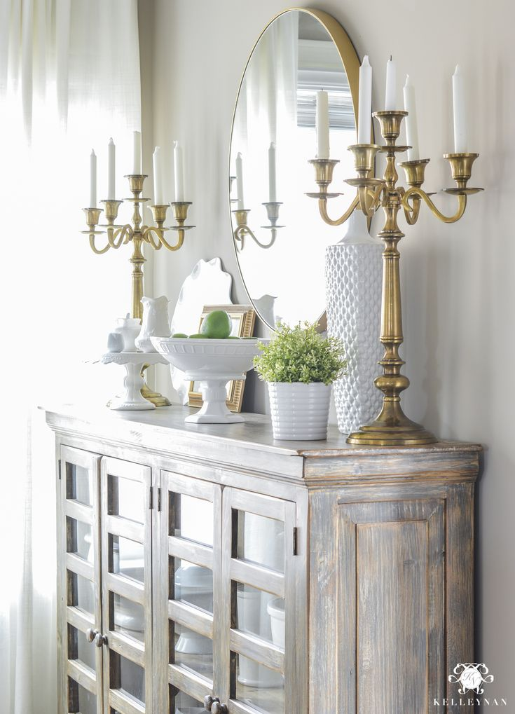 Updated Breakfast Nook- A Lighter, Brighter Look - Kelley Nan- Updated Breakfast Nook- A Lighter, Brighter Look - Kelley Nan Round Brass Mirror over Buffet with Candelabras. Shelf Styling Ideas. Perfect Greige Sherwin Williams Paint