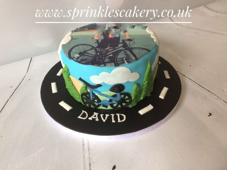 This birthday cake was wrapped with handcrafted fondant shapes and topped with an edible photo of the birthday boy, printed in-house in our kitchen. The image has been slightly obscured for privacy purposes.
