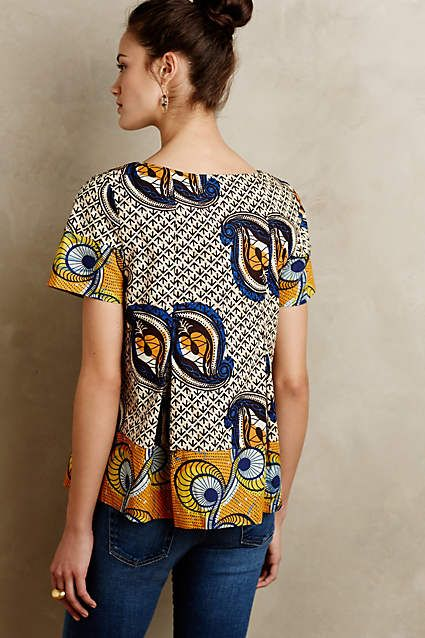 The Kora blouse from Anthropologie. Paired with white shorts & wedges...perfect summer outfit in my opinion. Going to have to get this.