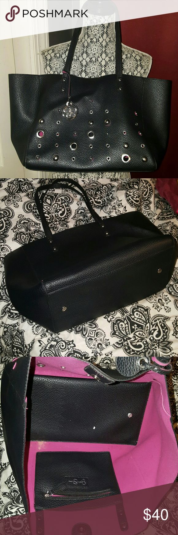 Jessica Simpson black grommet studded large tote This is a fabulous Jessica Simpson black grommet silver studded large tote Satchel bag. It is pre-owned I used it once on a weekend trip. It is in perfect condition. Measures 11x13x7 paid &99 plus tax. Super cute Jessica Simpson Bags Totes
