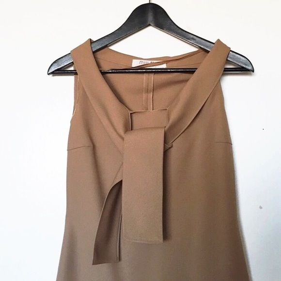 """Miu Miu dress in size small Very chic and sophisticated posh dress from Miu Miu  Worn once khaki faux scarf dress. Inseam from top to bottom 36 1/2"""". I'm really short and petite(5'1 97 pounds) so it should fill it better for others. Miu Miu Dresses"""