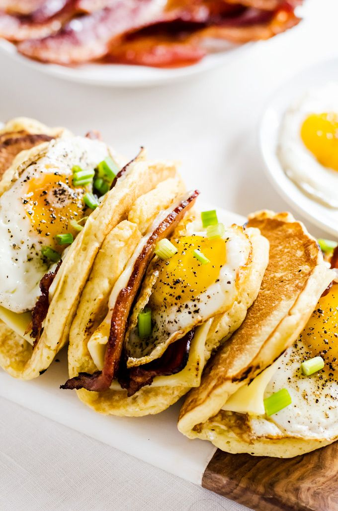 Light and fluffy pancakes act as a vehicle for thick slices of bacon, melted cheese, and fried eggs. Smother the whole thing in maple syrup and you have the best breakfast ever!