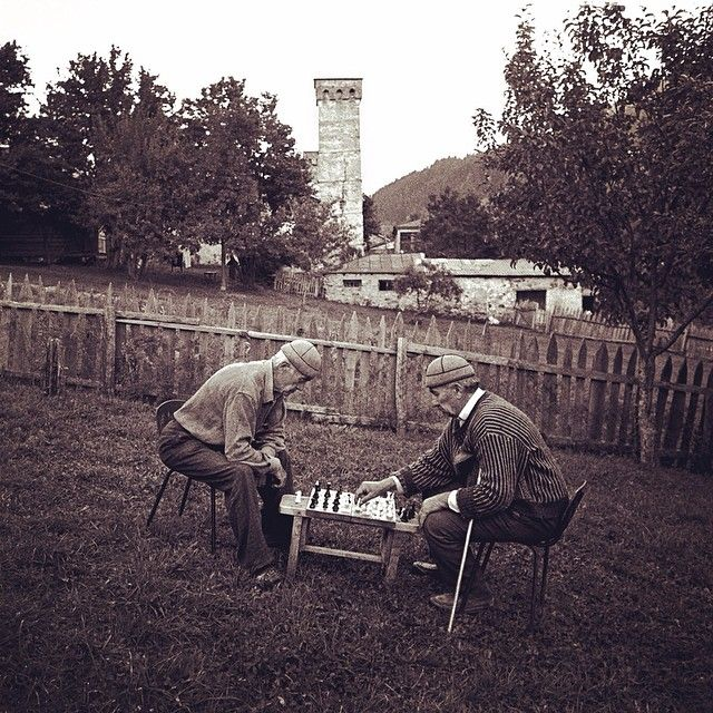 argonautphoto (Aaron Huey National Geographic photographer) This is an image from the first photo essay of my life (1999). It all began for me in a mountainous region of the Georgian Republic called Svaneti. In this image Garontee and Islam Pilpani play chess in the back yard. I found both men and photographed them playing chess with each other again last year! #Sakartvelo