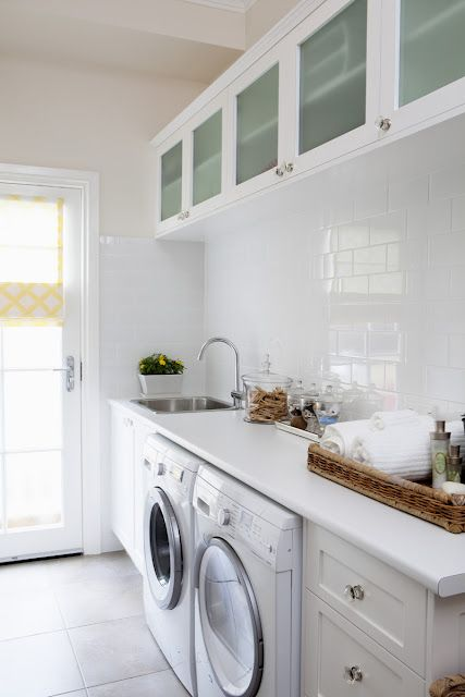Acceptably simple laundry room/mud room, except for that horrible white laminate countertop. Okay, and the paint colour.