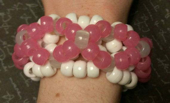 Check out this item in my Etsy shop https://www.etsy.com/listing/255021416/3d-kandi-cuff-pink-and-white-glow-in-the