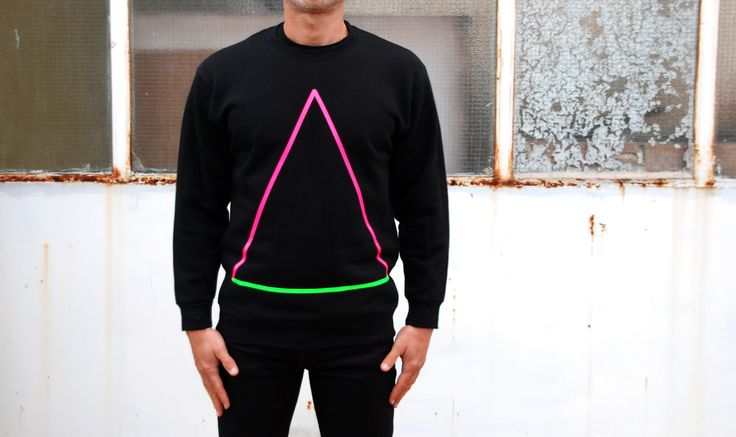 Sweatshirt Color: Black  80% Cotton  20% Polyester Design: Neon  Triangle